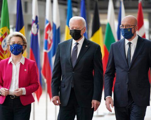 President Joe Biden, center, walks with European Council President Charles Michel, right, and European Commission President Ursula von der Leyen